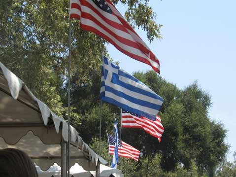 Greek and American flags.