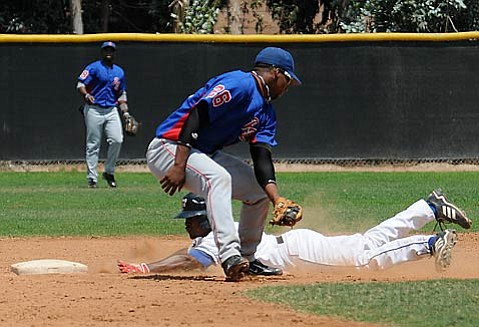 Santa Barbara Foresters' Andre Miller steals second base in the first game of Sunday's double-header against the Urban Youth Academy Barons.
