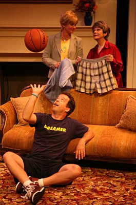 Morgan Rusler (seated), Stephanie Zimbalist, and Marcia Rodd are, for better or worse, all in the same family in David Rambo's new play <em>The Spin Cycle</em>.