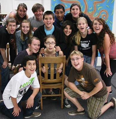 The 14 cast members of the original musical Newton's Cradle not only sang and acted, but also collaborated with its directors to create the show, much of which is based on their personal experiences.