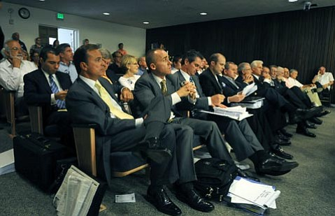 A HARD SELL: Following the Montecito Planning Commission's call for an SEIR on water issues, Caruso (front row, left) has stated that he is not interested in reducing the project, and selling the land is an option for him.
