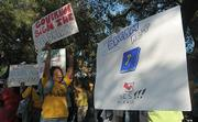 Supporters of SB 1301 rally outside the downtown library Friday Aug.15