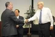 Gary Cunningham (right), outgoing director of intercollegiate athletics for UCSB welcomes Mark Massari to the position