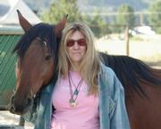 Author Deanne Stillman and Mona, a rescued Nevada mustang, at the Wild Horse Spirit sanctuary in Carson City, Nevada.