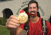 Todd Rogers shows off the Gold Medal he brought home from the Beijing Olympics
