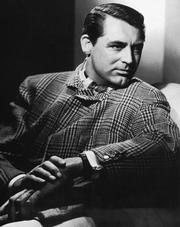 Cary Grant wearing a Prince of Wales checked jacket by Savile Row tailors Kilgour, French & Stanbury.