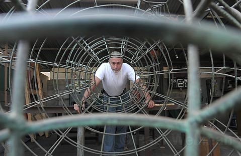 "Wild wires: Artist Ed Inks stands within the wire frame of his piece, ""The Birth of Bacchus,"" which was removed from State Street entirely after it was damaged twice, presumably by passers-by."