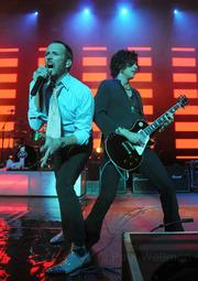 STP frontman Scott Weiland (left) belts through the hits with guitarist Dean DeLeo during last Saturday's tour-closing show.