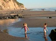 Kids play at Arroyo Burro Beach without worries thanks to the volunteers who help keep it clean each year.