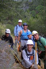 Volunteers helping brush out the Davy Brown Trail in the backcountry as part of National Trails Day.