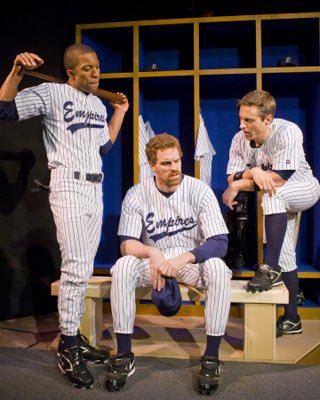From left: Jacques Cowart II as Darren Lemming, Travis Johns as Shane Mungitt, and Michael Polak as Kippy, all with their clothes on-for the moment-in ETC's production of Richard Greenberg's <em>Take Me Out</em>.