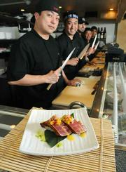 The chefs at Arigato Sushi serve up some delicious mango ahi nigiri.