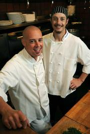 Executive Chef Josh Brown (left) and Chef Brandon Hughs keep it delicious at bouchon.