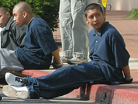 Ricardo Juarez sits handcuffed on the curb of State Street after the March 14, 2007 stabbing.
