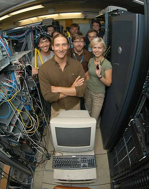 Giovanni Vigna, pictured with some of his former computer programming, gave a talk on October 23 about why electronic voting machines are flawed.