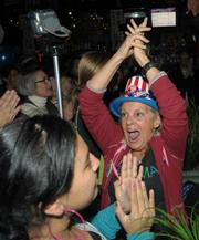 An ecstatic crowd at Stateside cheer on the election results