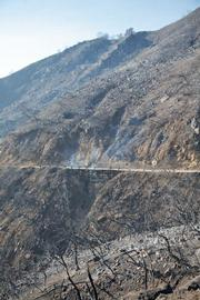 Vegetation along Gibraltar Road has been burned to mineral soil. Residents below on Mountain Drive will face serious threats from next winter's rains.