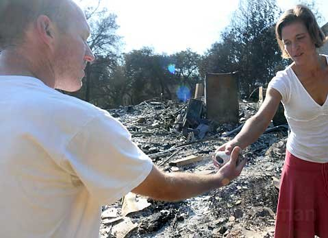 Dave Wolf and his wife Jill pick through the rubble of their home in Westmont College's faculty housing.
