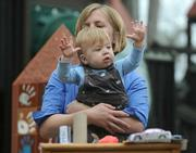 Goleta mom and business owner Carla Abatie-Neufeldt shared concerns about toy safety standards while holding her 11-month-old son, Max, who was simultaneously the most entertained and entertaining part of the CalPIRG press conference.