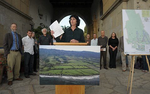 Lawsuit:  Flanked by members of the Naples Coalition and Surfrider Foundation, the EDC's Linda Krop (pictured at the podium) announces they are suing the County of Santa Barbara for its illegal approval of a plan to build 71 mansions on the Gaviota Coast.