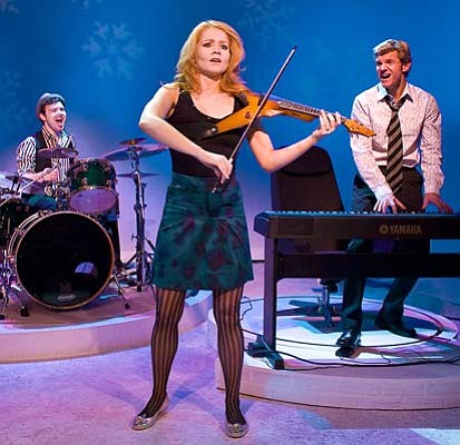 From left: Matt Wolpe, Charleene Closshey, and Brent Schindele play versions of themselves as well as musical instruments and other characters in <em>Striking 12</em>.