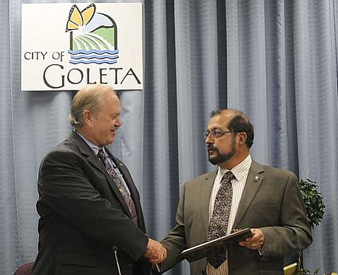 King of G-Town:  Outgoing Goleta mayor Michael T. Bennett (on left) congratulates Roger Aceves on his ascendancy to the mayoral seat. Often a swing vote during the council's previous incarnation, Aceves may lead the group through less divisive votes in the future.