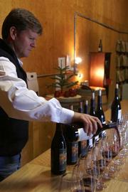 Brook Williams pours out a vertical selection of Zaca Mesa wines, going back to the early 1990s.