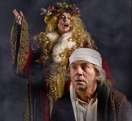 Susan Kelejian as the Ghost of Christmas Present looks over the shoulder of James Sutorius as Scrooge in<em> A Christmas Carol</em>.