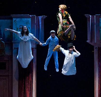 Sarah Bierstock as Wendy, Ryan Dalforno as Michael, Jordan Lemmond as John, and Corina Boettger as Peter Pan all take to the air in SBT's <em>Peter Pan</em>.