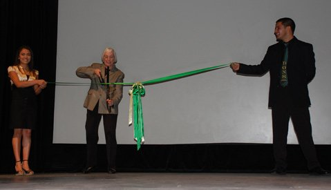 Marty Blum cuts the ribbon for the re-opening of the Dons Net Cafe.