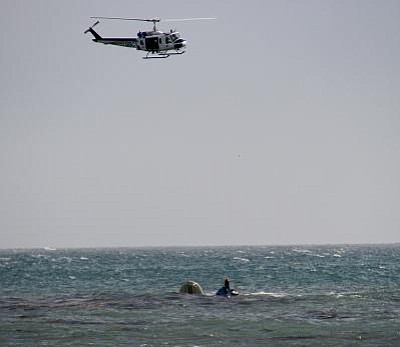 A rescue helicopter saved this capsized boat on Christmas morning.