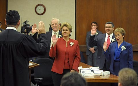 Santa Barbara Superior Court Judge Jed Beebe (left) joins Supervisors Doreen Farr, Salud Carbajal and Joni Gray in being sworn in by Judge Arthur Garcia Tuesday.