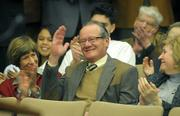 Outgoing 3rd District Supervisor Brooks Firestone salutes the applauding crowd