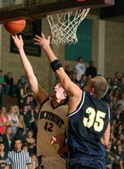 Westmont's Dan Rasp goes up for a layup against Vanguard.