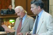 Defense attorney Robert Landheer and prosecutor Darryl Perlin go over Van Tassel's bail agreement