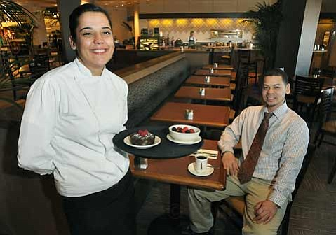 Cafe Nordstrom Lead Server Lilit Pepeyn (left) with a tray of fresh fruit and a pastry for cafe manager Christopher Culler.