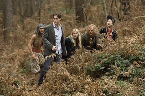 "Mo ""Silvertongue"" Folchart (Brendan Fraser), Meggie Folchart (Eliza Bennett), Dustfinger (Paul Bettany), and Elinor Loredan (Helen Mirren) in the movie version of the novel <em>Inkheart</em>."