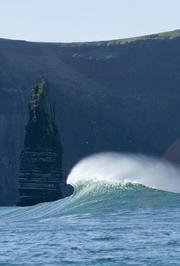 A wave breaks at 'Aileens' near the Cliffs of Moher, Co. Clare, Ireland.