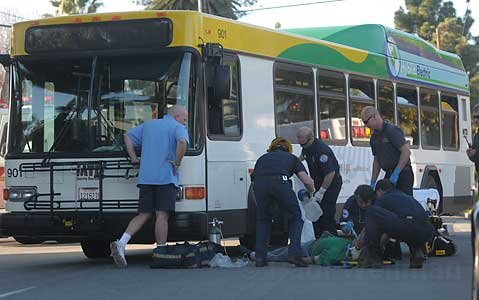 Rescue workers free a man that was hit and pinned down by a bus at the intersection of De la Vina and Figueroa Streets.