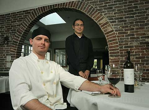 Epiphany's Sous Chef Taylor Melonuk (left) and server Travis Mock.