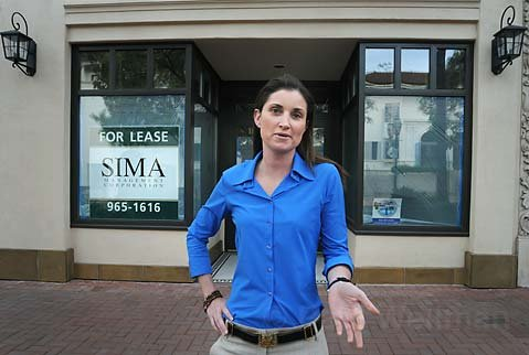 Anda Ashkar, Sr. Vice President & General Counsel for Sima Corporation, outside the newly renovated San Marcos Building at 1129 State Street