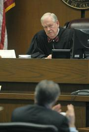 Judge J. William McLafferty listens to arguments from Fred Woocher, legal council for Doreen Farr