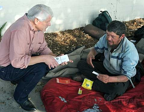 FATAL INJURIES:  Ross Stiles-seen here speaking with homeless outreach worker Ken Williams (left) on December 4-died at Cottage Hospital on February 4. His friends claim a February 1 assault caused the massive head injury that killed him.