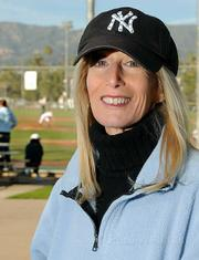 Jane Heller loves the Yankees-a lot. And her newest book (left) tells you all about it.