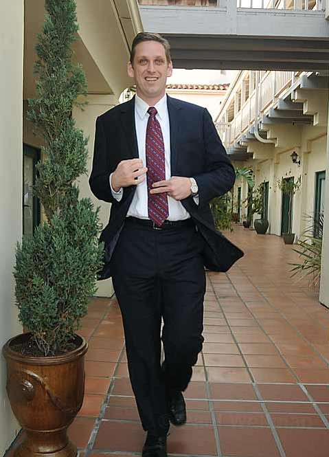 State Senator Tony Strickland heads out to meet the crowd gathered in celebration on the patio of his new Santa Barbara office in the Anacota building