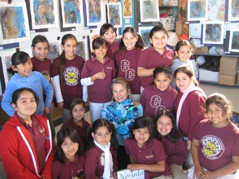 Mary Heebner (center) with students at Cesar Chavez Elementary