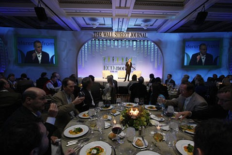 Corporate execs from around the country dine at the Bacara as they listen to Wall Street Journal editor Robert Thompson explain how the ECO:nomics conference will help them green their business.