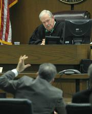 Judge William McLafferty listens to Fred Woocher's final comments