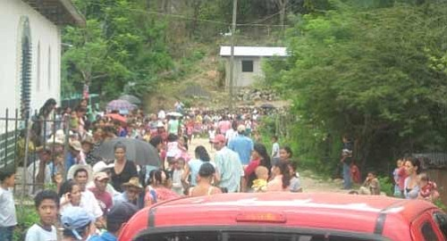 Hondurans line up for healthcare during one of Global Medical Brigade's previous trips.