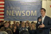 San Francisco Mayor Gavin Newsom speaks to crowd at the Veterans Memorial building